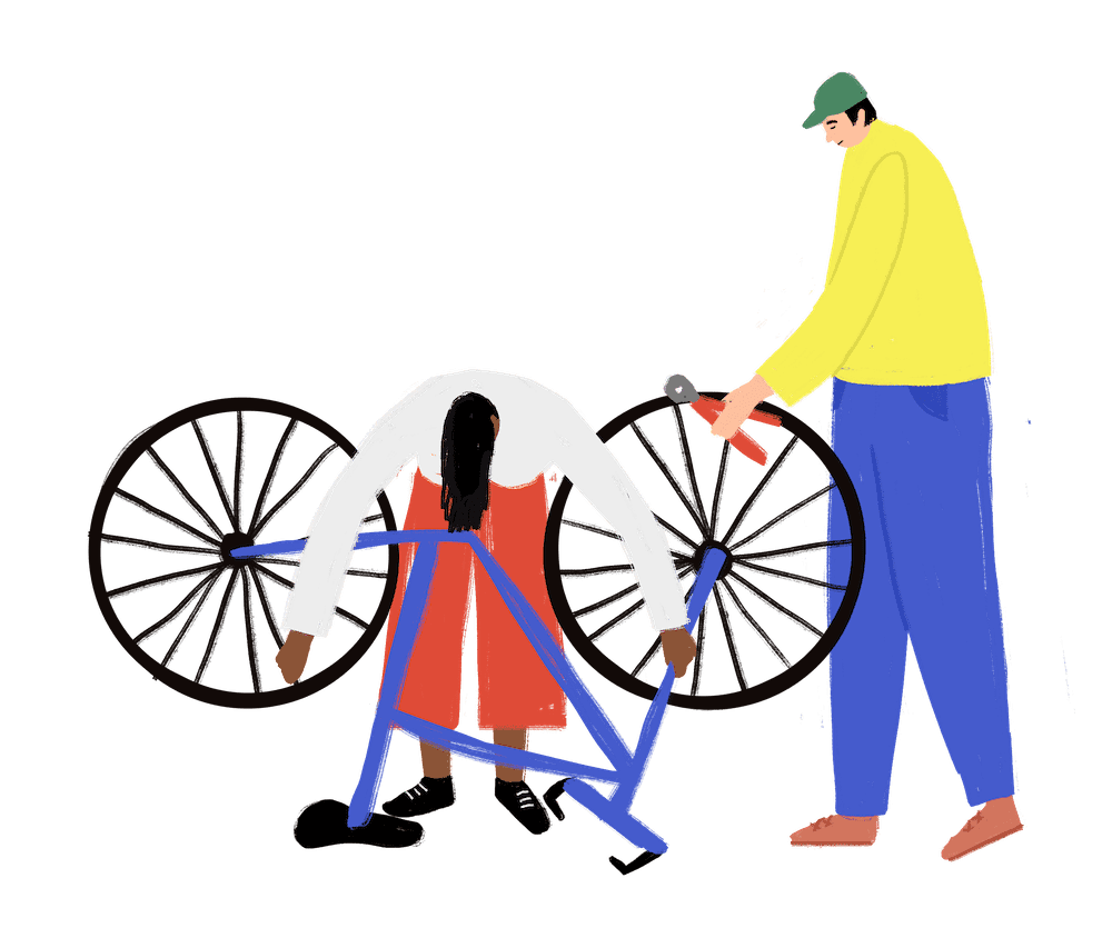 two people repairing a bike